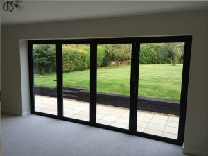 Extension with Bi-Folding doors and Patio with sleepers also supplied and fitted by THI.