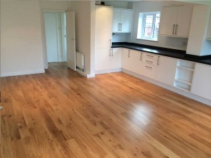 Kitchen and floor supplied and fitted by THI.